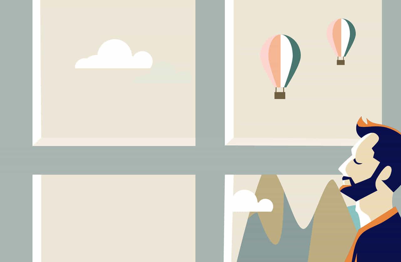 気球が飛んでいるのが見える部屋の男