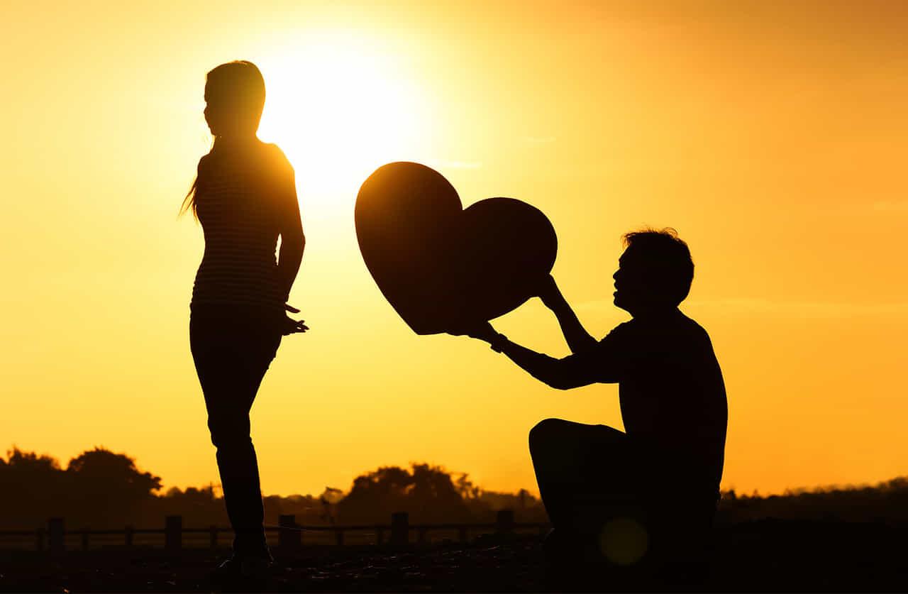 女性に男性が大きな愛を示してアプローチする様