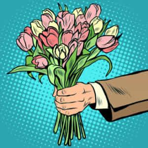 女性に求愛するため花束を渡す男性